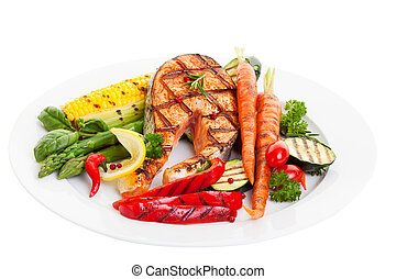 Salmon Dinner - Grilled salmon steak with vegetables corn...