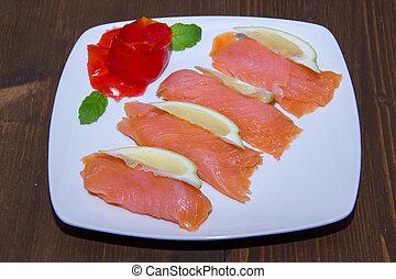 Salmon dish on wood
