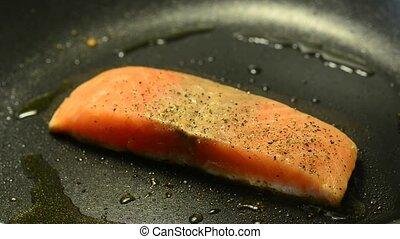 Salmon filet, roasting in a pan