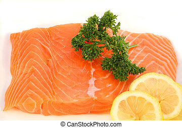 Salmon fillet garnished - A raw salmon fillet, with English ...