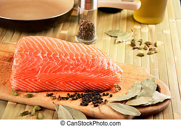 salmon fillet on a cutting board on the table. on the table...