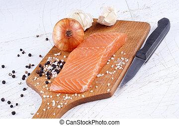salmon fillet on a wooden board