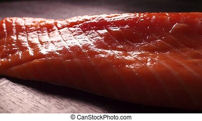 Salmon fillet rotating on a black table