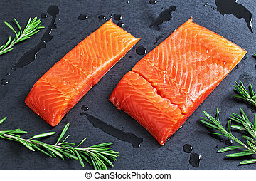 salmon fillet with fresh rosemary and drops of olive oil