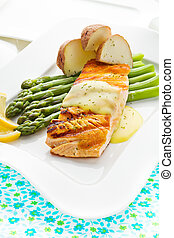 Salmon fish meal with potato and asparagus vegetable.