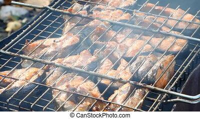 salmon fish on grilling sticks