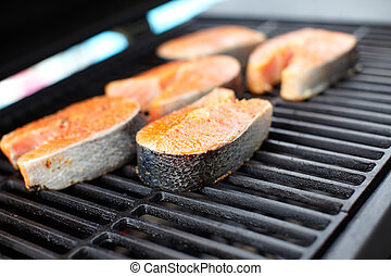 Salmon fish roast on barbecue grill.