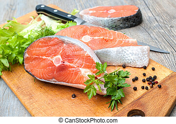 Salmon fish steaks - Raw salmon fish steaks with fresh herbs...