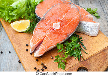 Salmon fish steaks - Raw salmon fish steaks with fresh herbs...