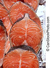 Salmon fish vivid slices in a row, marketplace textures