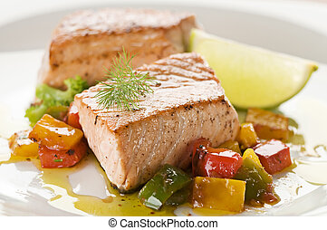 Salmon - Grilled salmon steak with vegetables close up
