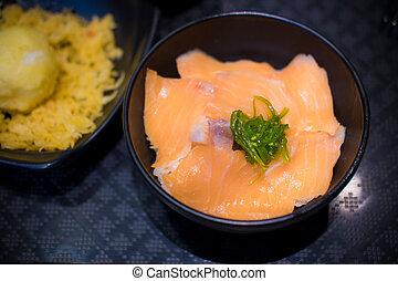 Salmon Ikura Don in bowl on table at Japanese food ...