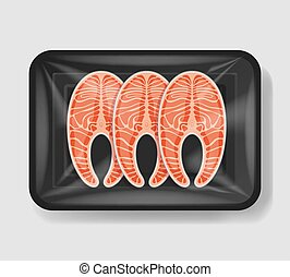 Salmon in plastic tray container with cellophane cover....