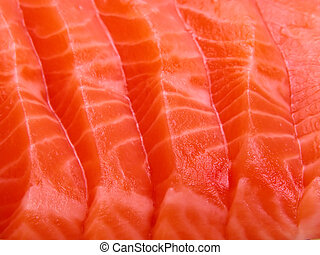 Extreme close-up of few pieces of raw salmon meat.