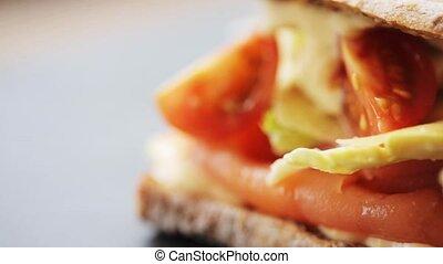 salmon panini sandwich at restaurant - food, dinner and...