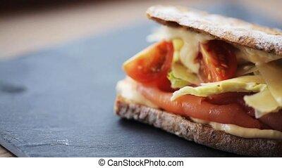 salmon panini sandwich on stone plate - food, dinner and...