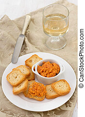 salmon pate with mini toasts on the plate
