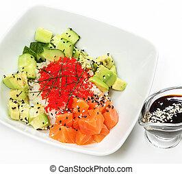 Salmon poke with Japanese rice, Tobiko caviar with fresh ...