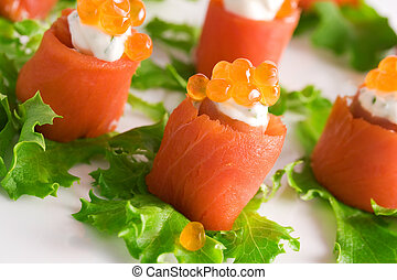 Close-up of salmon rolls with red caviar