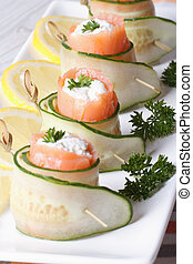 salmon rolls with cucumber, cream cheese macro vertical
