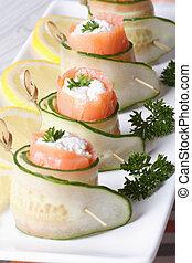 salmon rolls with cucumber, cream cheese macro vertical