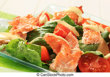 Salmon salad drizzled with Hollandaise sauce