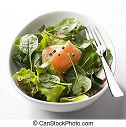 Salmon salad - Fresh green salad with smoked salmon close up
