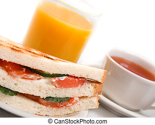 salmon sandwiches and glass of juice