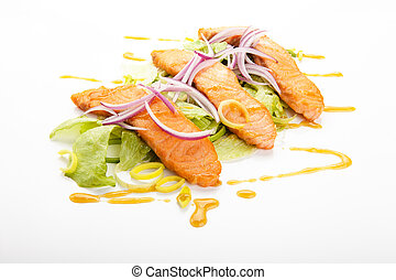 Salmon sashimi with lettuce, green onion and sauce, on a white background