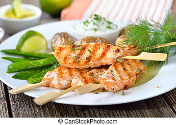 Salmon skewers - Grilled salmon skewers served with snow ...