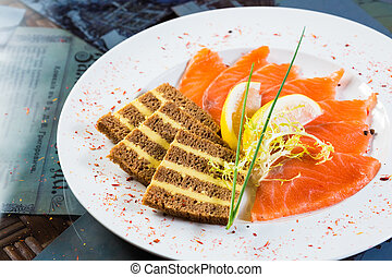Salmon snack on the white plate,