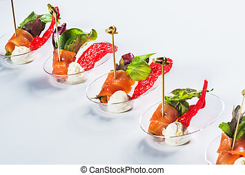 Salmon snack with soft cheese, fresh salad and basil