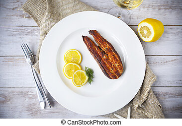 Salmon steak grilled with lemon and white wine