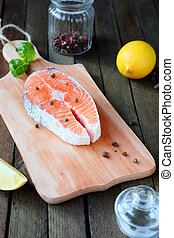 Salmon steak on a cutting board