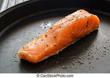 salmon steak on a frying pan