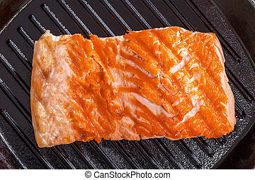 salmon steak on a iron gril pan - Delicious salmon steak on...