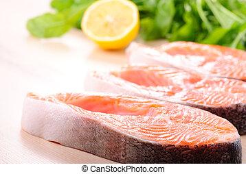 Salmon steak raw - Raw salmon steak in row, prepared for ...