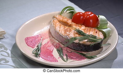 Salmon steak sprinkled with rosemary. Slow motion - Salmon...