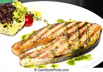Salmon steak with herbs and lemon
