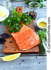 Salmon steak with lemon on a cutting board