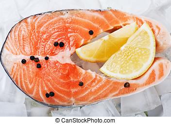 salmon steak with slices of lemon