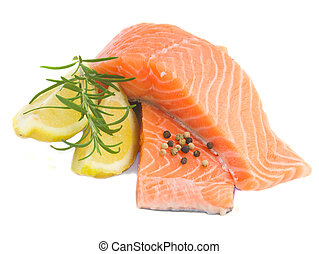 salmon steaks - raw salmon steaks with rosemary and spices...