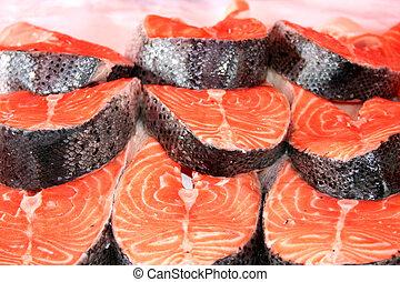 Salmon Steaks - Digital photo of salmons taken at a...