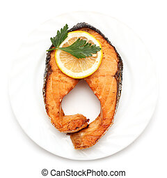 Salmon with lemon on a plate on a white background
