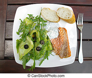 Salmon with salad on a plate