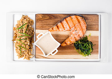Salmon with Thai rice and sauce on white background