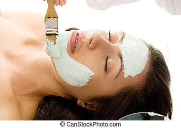 Salon Treatment - A mask is applied at a beauty salon