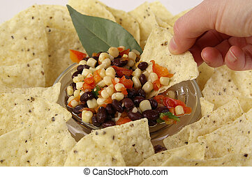 salsa and chips - Serving a bowl of tortilla chips and salsa