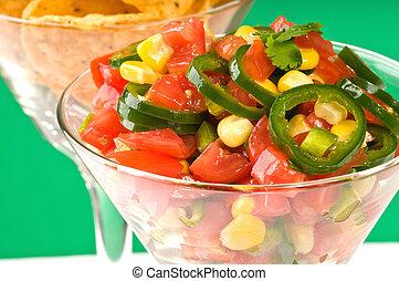 Salsa Closeup - Closeup of homemade spicy salsa in a glass.