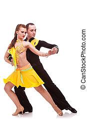 salsa dancing couple in ballroom